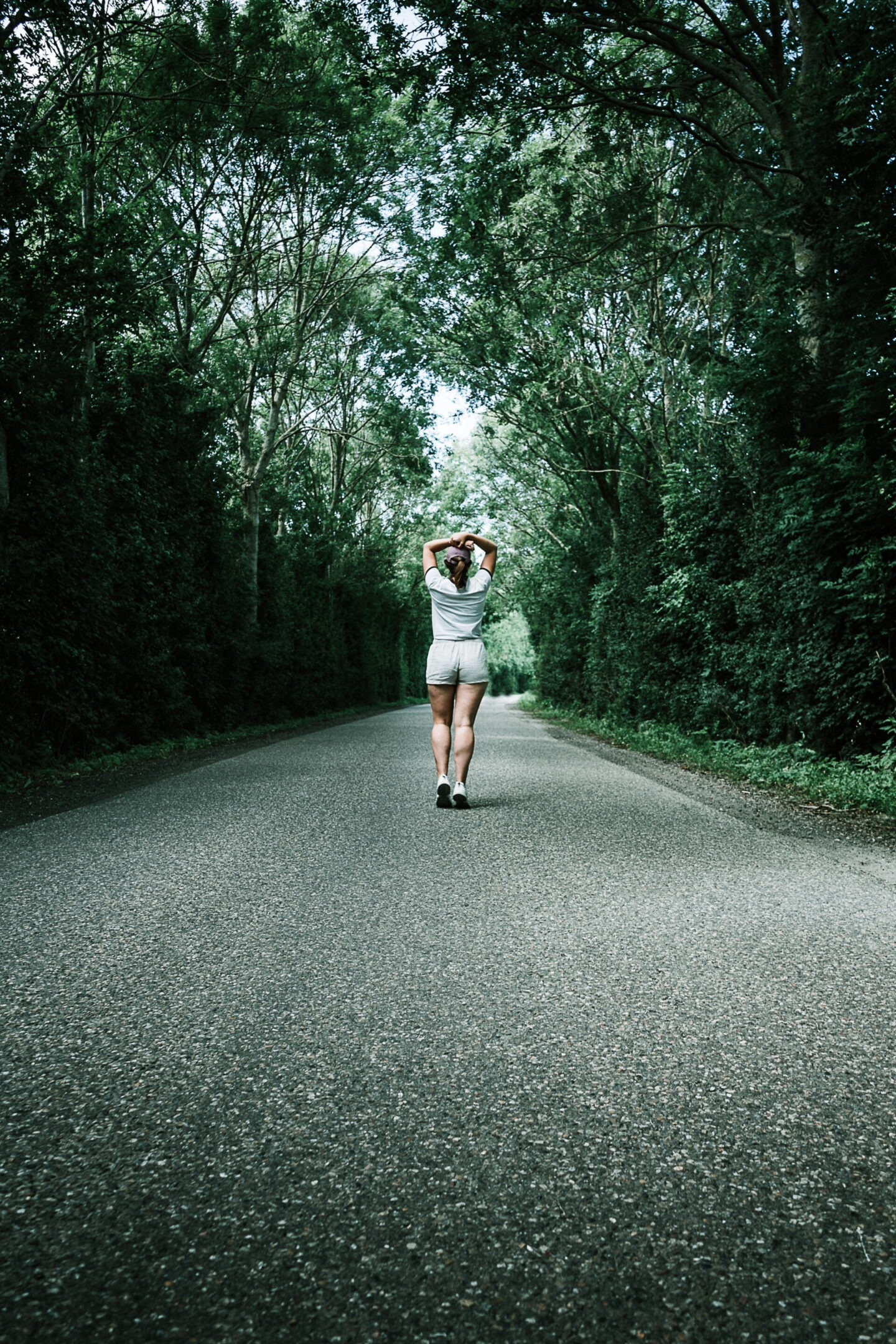 woman running on rural road - exercise